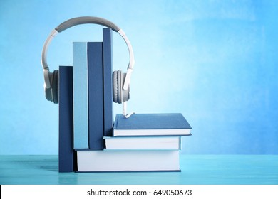Headphones and books on table. Concept of audiobook