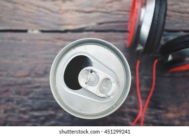 Headphones with cola can