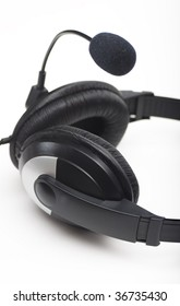 Headphones with details over white background.