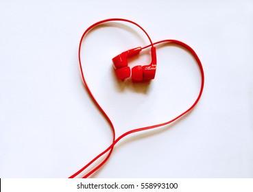Headphones earphones red heart shape on white background /  Love music