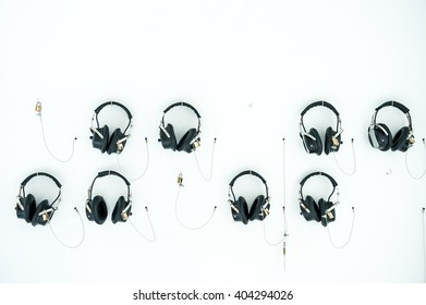Headphones hanging on the white wall with master keys locked ,is