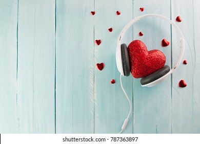 Headphones and heart concept for love listening to music. Listen to your heart. Valentine's Day