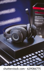 Headphones and keyboard for gaming.