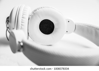 Headphones for music sound. White headphones on white background