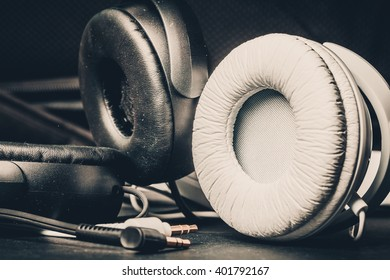 Headphones on black background. Selective focus. Color toned.