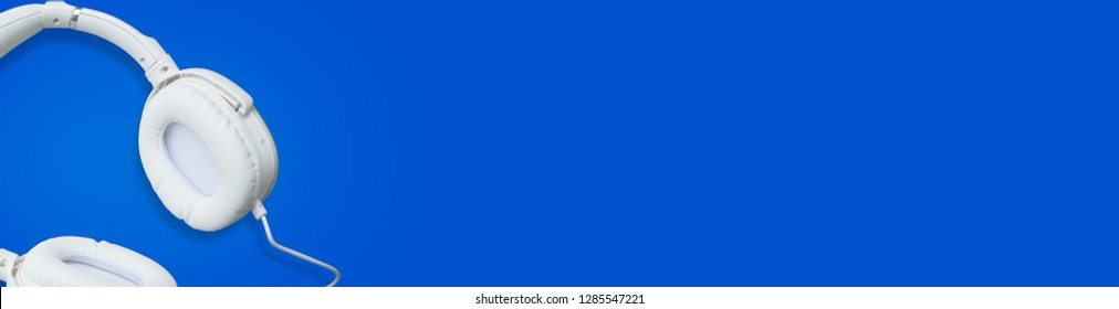 Headphones on blue space - Banner design template background