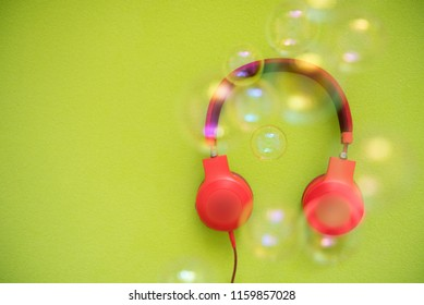 Headphones on a colorful background.