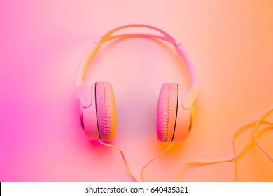 Headphones on colorful (multicolor tonal transitions) background. Poster layout with free text (copy) space.