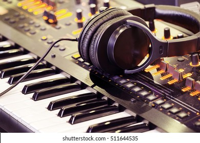 Headphones on musical synthesizer keyboard.