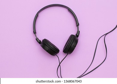 Headphones on a purple background