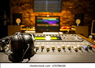 headphones on sound mixer in digital recording studio