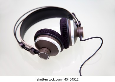 Headphones on a whiteand reflective background
