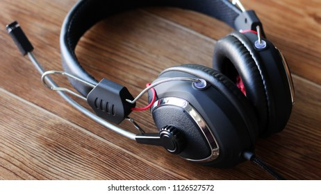 Headphones on wooden background, sound device so close