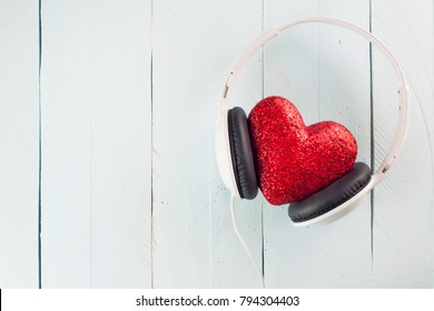 Headphones with red heart. love music. Listen to your heart. St. Valentine's Day