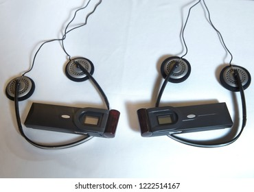 Headphones for simultaneous translation . wireless multy language headphones set on the chairs in conference room