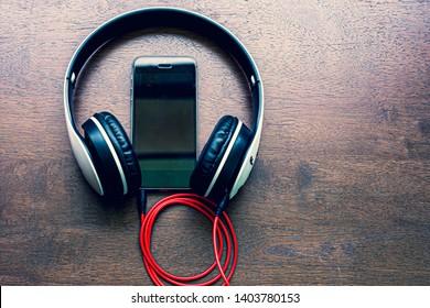 Headphones and smartphone ,Desk, Headphones, Smart Phone, Above, Arts Culture and Entertainment