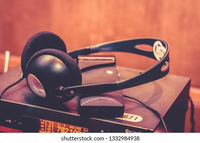 headphones used for simultaneous translation equipment simultaneous interpretation equipment wireless multi language headphones set on the chairs in conference room.