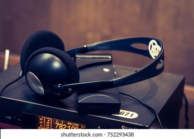 headphones used for simultaneous translation equipment simultaneous interpretation equipment wireless language headphones set on the chairs in conference room. Monochromatic