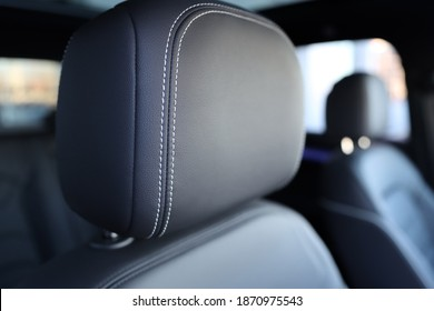 The headrest of the car. Leather headrest in black color