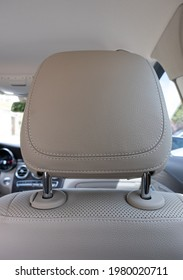 headrest in modern luxury comfortable car with the beige perforated leather