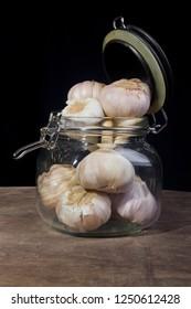 Heads of garlic in a glass jar
