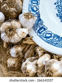 heads of garlic and a plate closeup