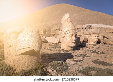Heads of the gods on East terrace at the top of Nemrut Mountain (Nemrut Dagi) in Turkey. The UNESCO World Heritage Site at Mount Nemrut where King Antiochus is reputedly entombed. With sunshine