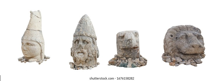 Heads on East terrace at the top of Nemrut dagi in Turkey. The UNESCO World Heritage Site at Mount Nemrut where King Antiochus is reputedly entombed. Isolated on white background.