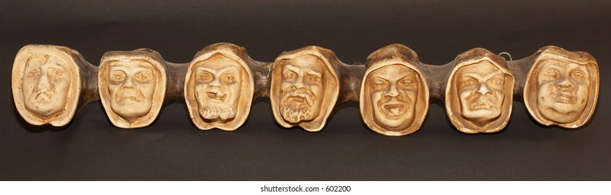 Heads symbolizing the seven deadly sins
