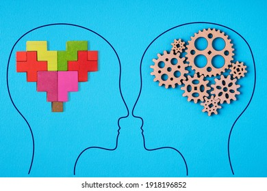 Heads of two people with abstract brain and heart. The concept of logic vs feels.