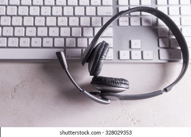Headset and computer keyboard representing customer support