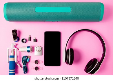 Headset listen music with mobile phone and Accessory set technology Blank space on bright pink background