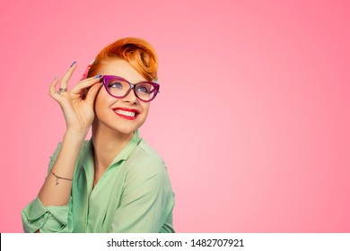 Headshot Attractive Young Woman pinup girl holding Glasses laughing smiling happy looking at you isolated on pink color background. 50s retro vintage hair style. Positive Human emotions body language