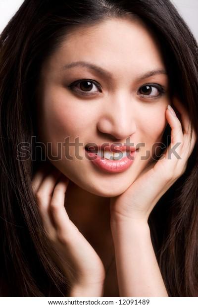 A headshot of a beautiful asian woman
