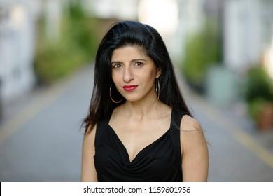 a headshot of a beautiful indian woman