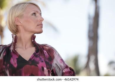 Headshot of a beautiful young female outside