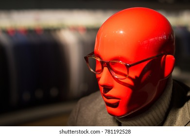 Headshot of a bright red man manniquin featuring fashion clothing for men
