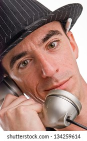 Headshot of a Caucasian Male Wearing a Fedora Style Hat and Talking on the Phone - Extreme Closeup