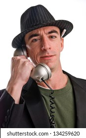 Headshot of a Caucasian Male Wearing a Fedora Style Hat and Talking on the Phone - Head and Shoulders