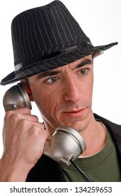 Headshot of a Caucasian Male Wearing a Fedora Style Hat and Talking on the Phone