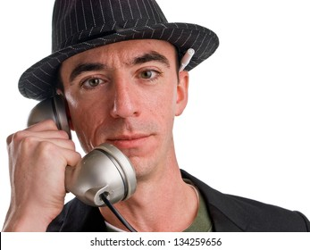Headshot of a Caucasian Male Wearing a Fedora Style Hat and Talking on the Phone - Closeup