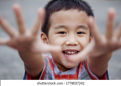 headshot of cheerful asian children looking with eye contact to camera