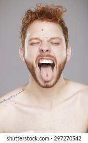 Male tongue piercing