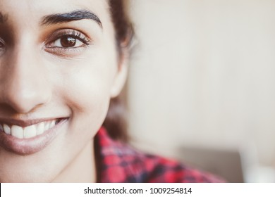 Headshot of happy young Indian woman