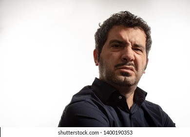 Headshot of man frowning with perplexed or disgusted expression, isolated on white background.