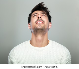 headshot of man suffering from something looking up