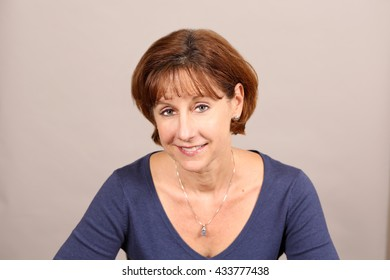 headshot of mature woman with brown hair