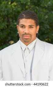 Headshot of mid aged multiethnic black man of African American and Italian ethnicity