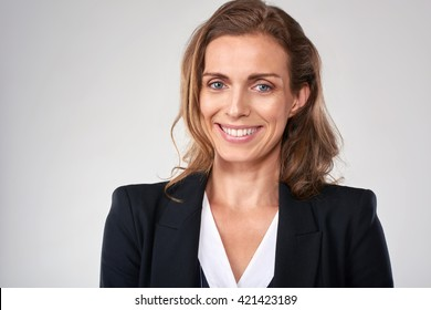 Headshot of middle age business woman in studio, isolated on grey