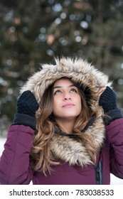 Headshot of a middle eastern woman in the winter.